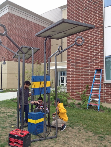 Engineering students working on solar tree